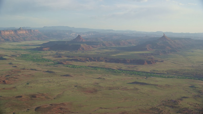 6K stock footage aerial video approaching South Six-Shooter Peak, North Six-Shooter Peak in a hazy valley, Moab, Utah Aerial Stock Footage | AX138_258