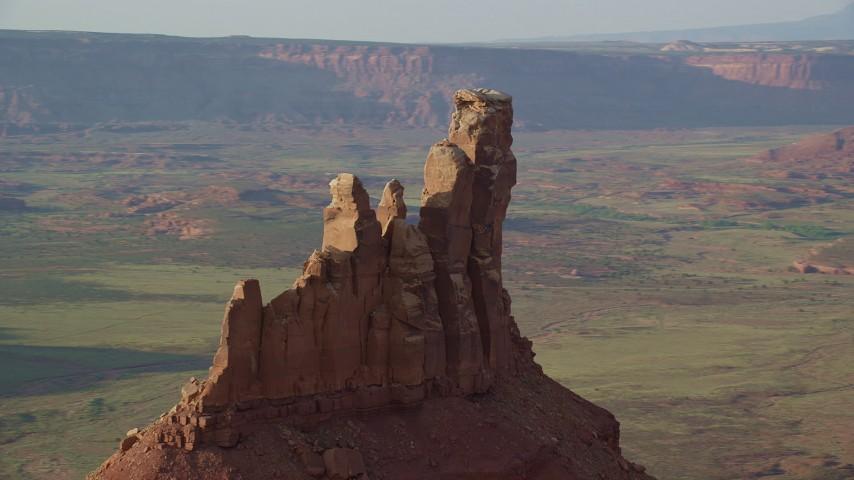 6K stock footage aerial video orbit the side of North Six-Shooter Peak, Moab, Utah Aerial Stock Footage | AX138_270