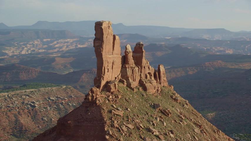 Orbiting North Six-SHooter Peak, desert valley, Moab, Utah Aerial Stock Footage   AX138_273