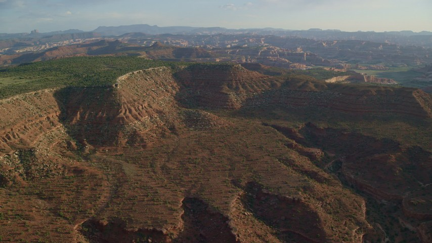6K stock footage aerial video of passing by desert mesa and box canyon, Moab, Utah Aerial Stock Footage | AX138_276