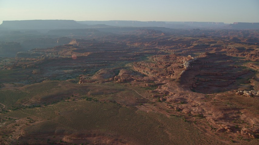 6K stock footage aerial video approach rock formations and canyons in Canyonlands National Park, Utah, sunset Aerial Stock Footage | AX138_287