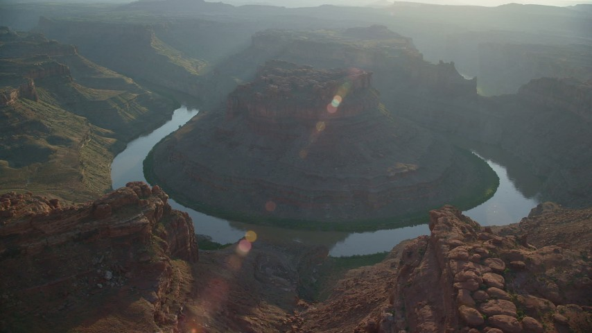 6K stock footage aerial video orbit The Loop East in Meander Canyon and Colorado River, Canyonlands National Park, Utah, sunset Aerial Stock Footage | AX138_291