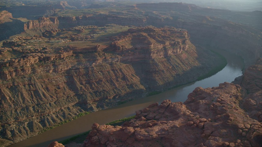 6K aerial stock footage video flyby The Loop West part of Meander Canyon and Colorado River, Canyonlands National Park, Utah, sunset Aerial Stock Footage | AX138_295