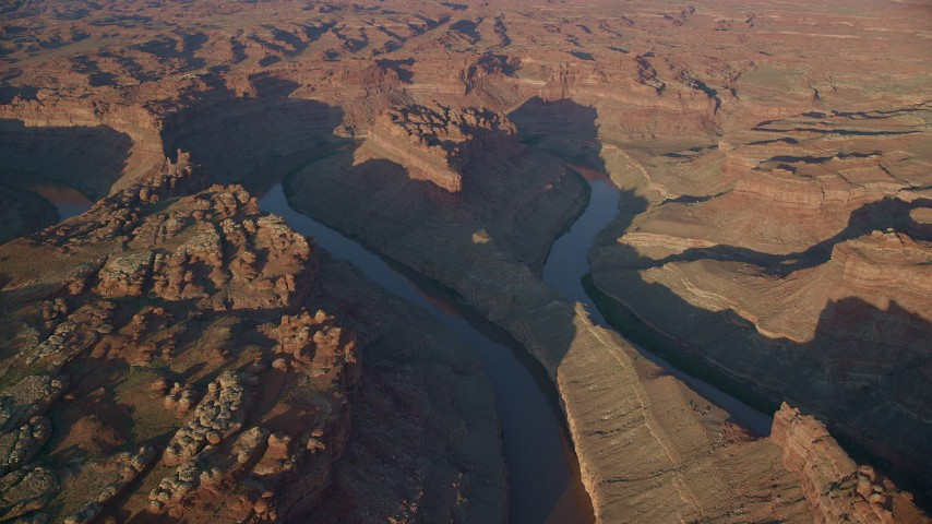6K stock footage aerial video orbit The Loop West, The Loop East in Meander Canyon, and Colorado River, Canyonlands National Park, Utah, sunset Aerial Stock Footage | AX138_301