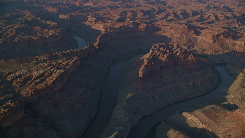 6K stock footage aerial video of The Loop West, The Loop East parts of Meander Canyon and Colorado River, Canyonlands National Park, Utah, sunset Aerial Stock Footage | AX138_303