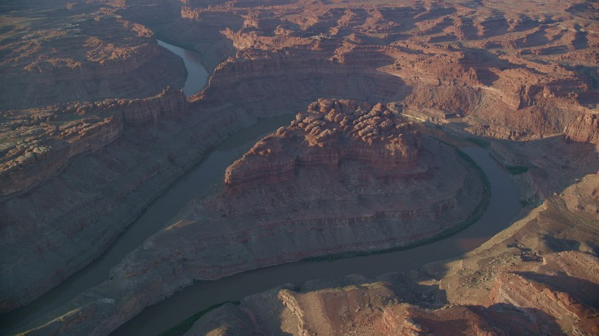 The Loop East, Meander Canyon, Colorado River,  Canyonlands National Park, Utah, sunset Aerial Stock Footage | AX138_304