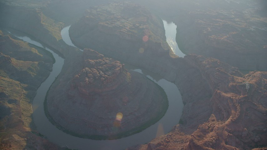6K stock footage aerial video of the river at the bottom of The Loop East, Meander Canyon, Canyonlands National Park, Utah, sunset Aerial Stock Footage | AX138_309