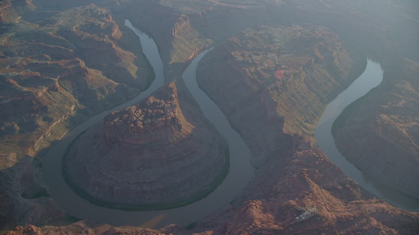 The Loop East, The Loop West, Meander Canyon, Colorado River, hazy, Canyonlands National Park, Utah, sunset Aerial Stock Footage | AX138_311