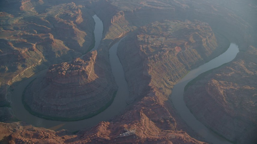 6K stock footage aerial video of circling the river in Meander Canyon at sunset in Canyonlands National Park, Utah, sunset Aerial Stock Footage | AX138_312