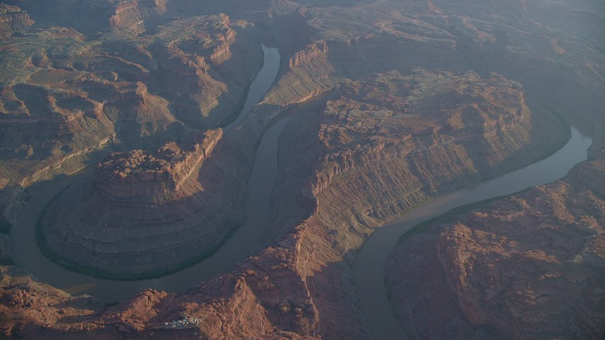 6K stock footage aerial video of orbiting around the river in Meander Canyon at sunset in Canyonlands National Park, Utah Aerial Stock Footage | AX138_313