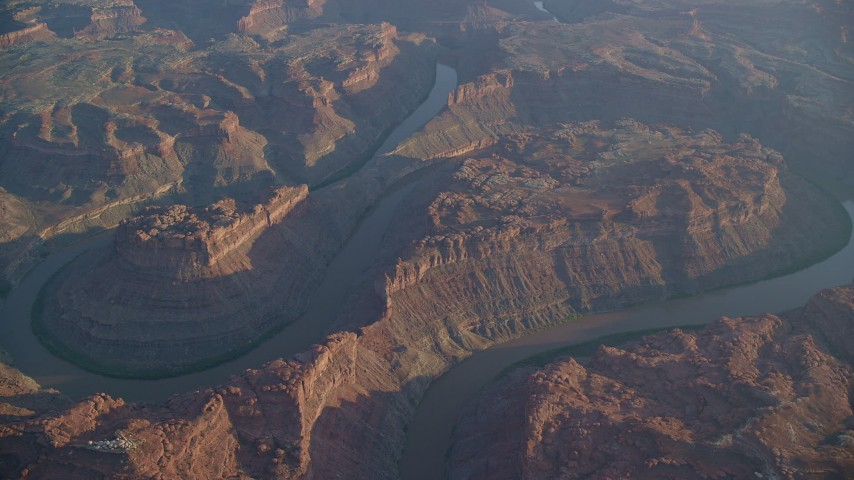 6K stock footage aerial video of the river flowing through Meander Canyon in Canyonlands National Park, Utah, sunset Aerial Stock Footage | AX138_314