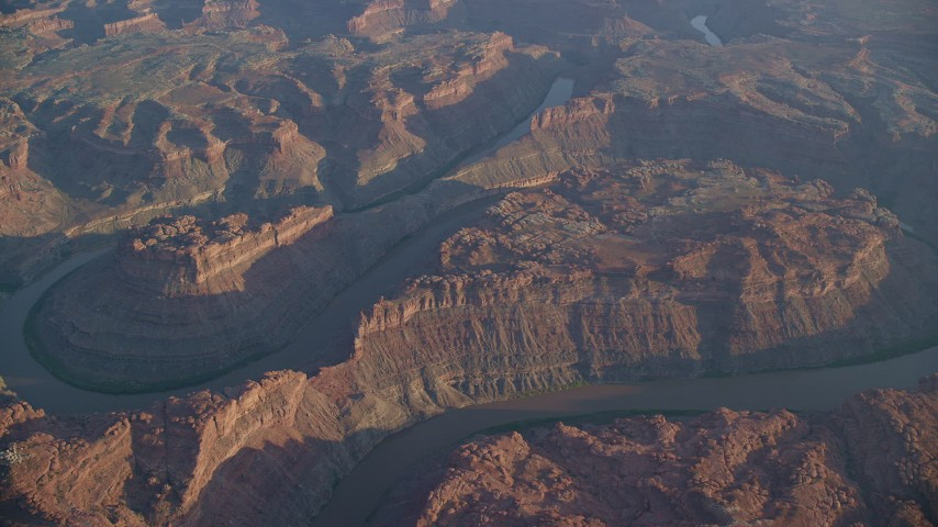 6K stock footage aerial video of orbiting the river flowing through Meander Canyon, Canyonlands National Park, Utah, sunset Aerial Stock Footage | AX138_315