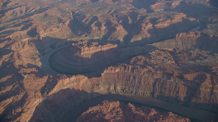 6K stock footage aerial video of slowly orbiting the river in Meander Canyon, Canyonlands National Park, Utah, sunset Aerial Stock Footage | AX138_316