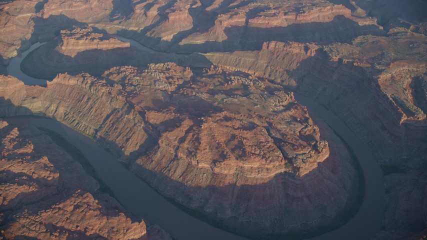 6K stock footage aerial video of The Loop West, Meander Canyon, and Colorado River at sunset, Canyonlands National Park, Utah Aerial Stock Footage | AX138_319