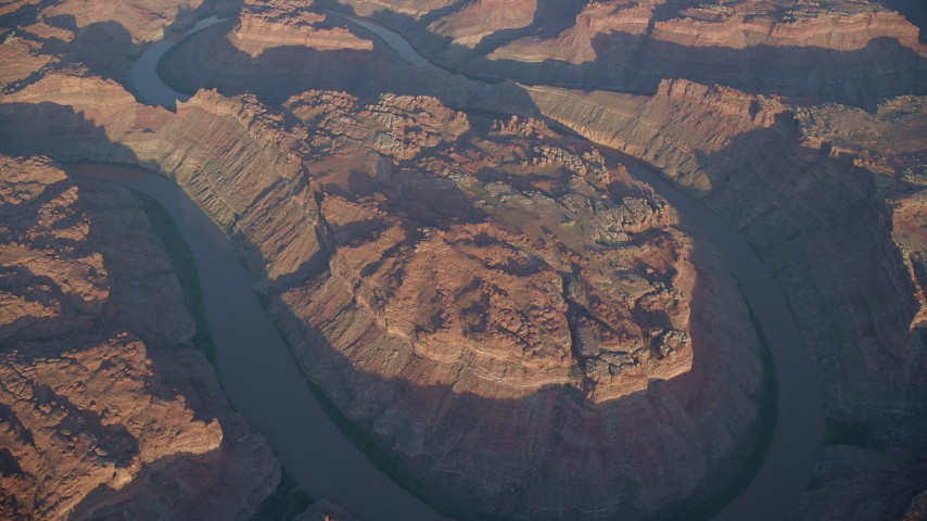 6K stock footage aerial video orbit The Loop West, Meander Canyon, with view of Colorado River, Canyonlands National Park, Utah, sunset Aerial Stock Footage | AX138_320