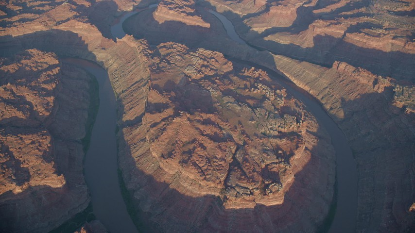 6K stock footage aerial video bird's eye view of The Loop West, Meander Canyon, and Colorado River, Canyonlands National Park, Utah, sunset Aerial Stock Footage | AX138_321