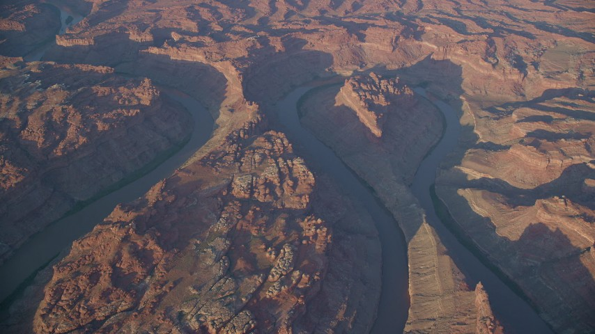 6K stock footage aerial video of the river flowing through Meander Canyon at sunset, Canyonlands National Park, Utah Aerial Stock Footage | AX138_324