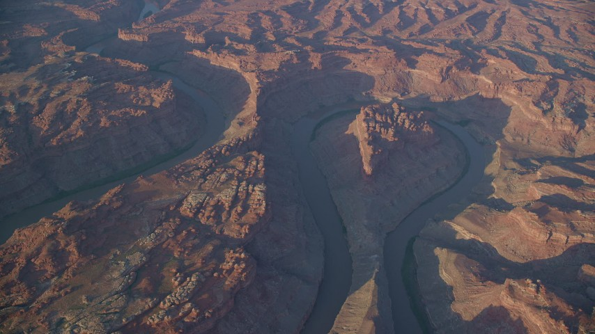 The Loop East, Meander Canyon, Colorado River, hazy, Canyonlands National Park, Utah, sunset Aerial Stock Footage | AX138_326