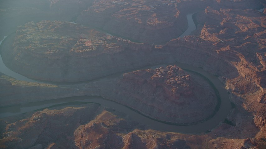 6K stock footage aerial video circle the Colorado River in Meander Canyon at sunset, Canyonlands National Park, Utah Aerial Stock Footage | AX138_329