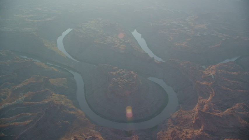 6K stock footage aerial video of Colorado River in Meander Canyon at sunset, Canyonlands National Park, Utah Aerial Stock Footage | AX138_332