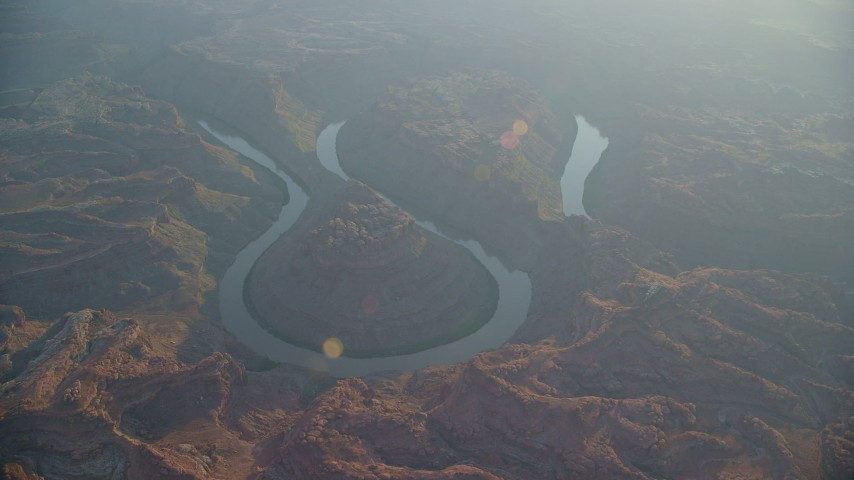 6K stock footage aerial video circling Colorado River in Meander Canyon at sunset, Canyonlands National Park, Utah Aerial Stock Footage | AX138_334