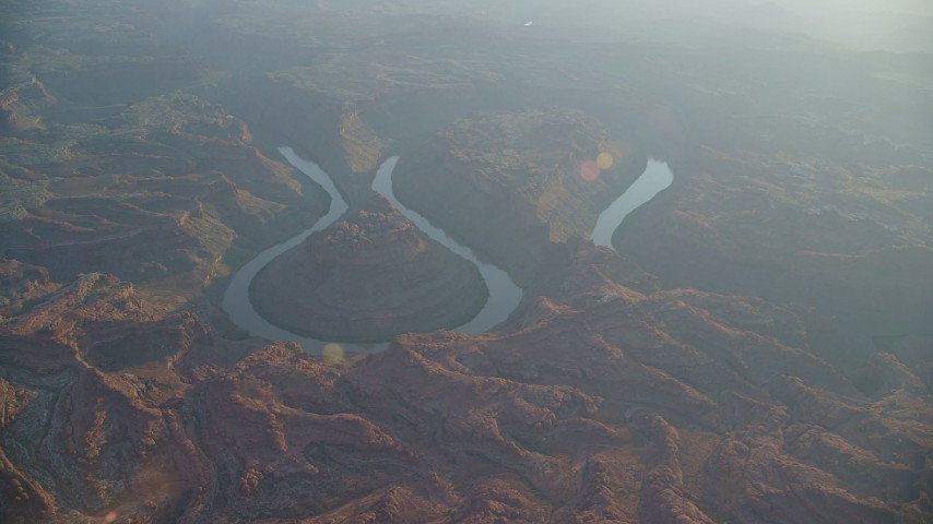 6K stock footage aerial video wide orbit of Colorado River in Meander Canyon at sunset, Canyonlands National Park, Utah Aerial Stock Footage | AX138_335
