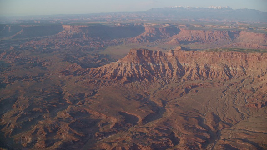 6K stock footage aerial video of approaching Lockhart Canyon and mesas, Moab, Utah, sunset Aerial Stock Footage | AX138_338