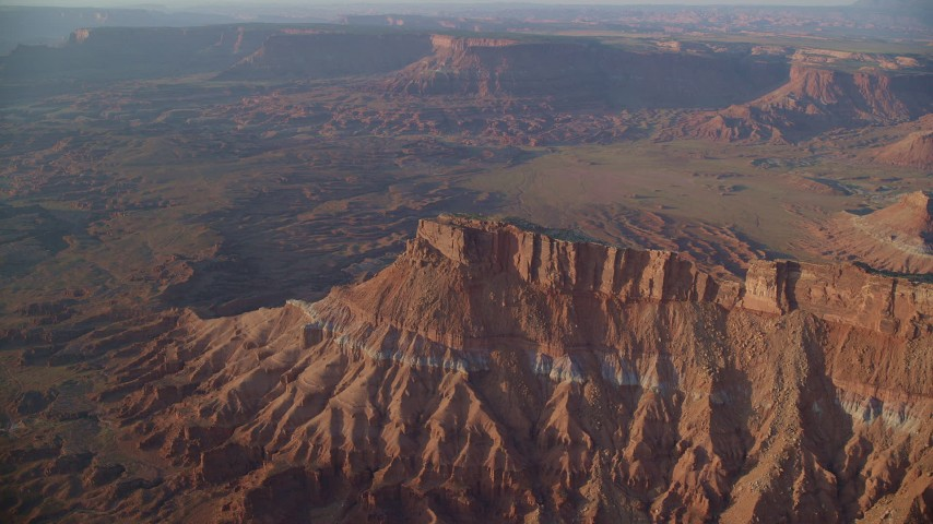 6K stock footage aerial video of focusing on a butte near Lockhart Canyon, Moab, Utah, sunset Aerial Stock Footage | AX138_341