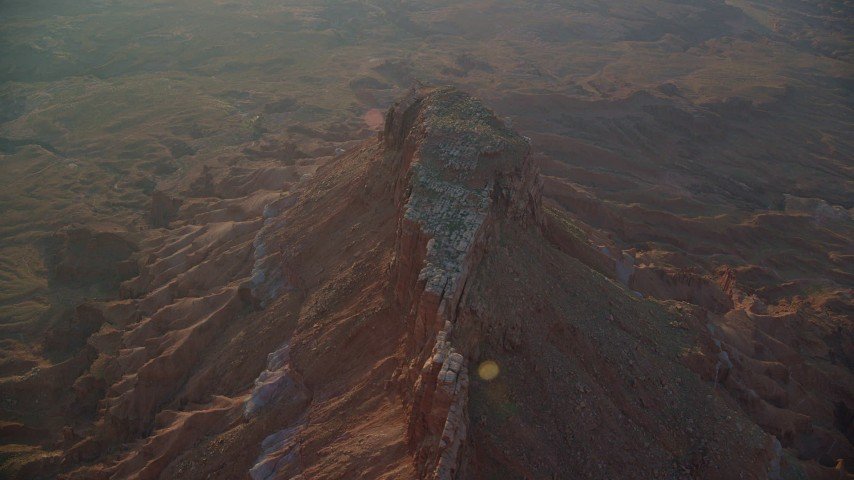 6K stock footage aerial video of circling a butte near Lockhart Canyon, Moab, Utah, sunset Aerial Stock Footage | AX138_343