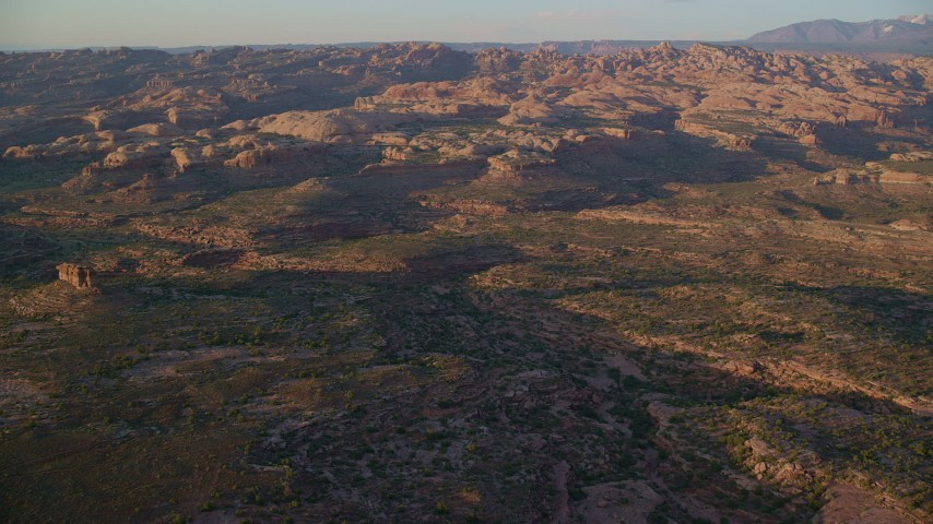 6K stock footage aerial video of approaching desert rock formations, Moab, Utah, sunset Aerial Stock Footage | AX138_366