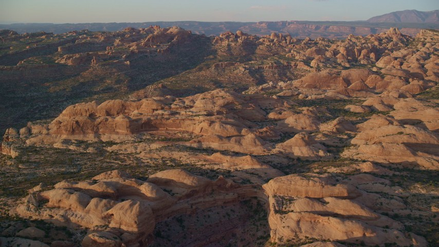 6K stock footage aerial video of flying over box canyon and rock formations, Moab, Utah, sunset Aerial Stock Footage | AX138_370