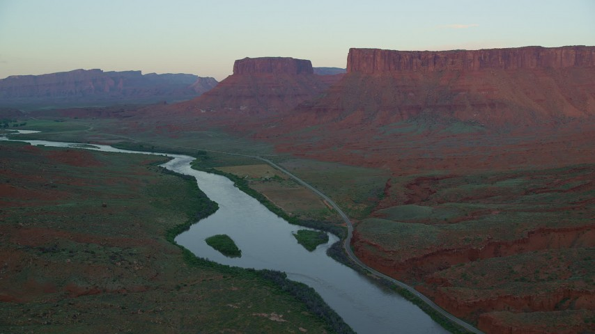 Colorado River, State Route 128, Parriott Mesa, Moab, Utah, sunset Aerial Stock Footage   AX138_403