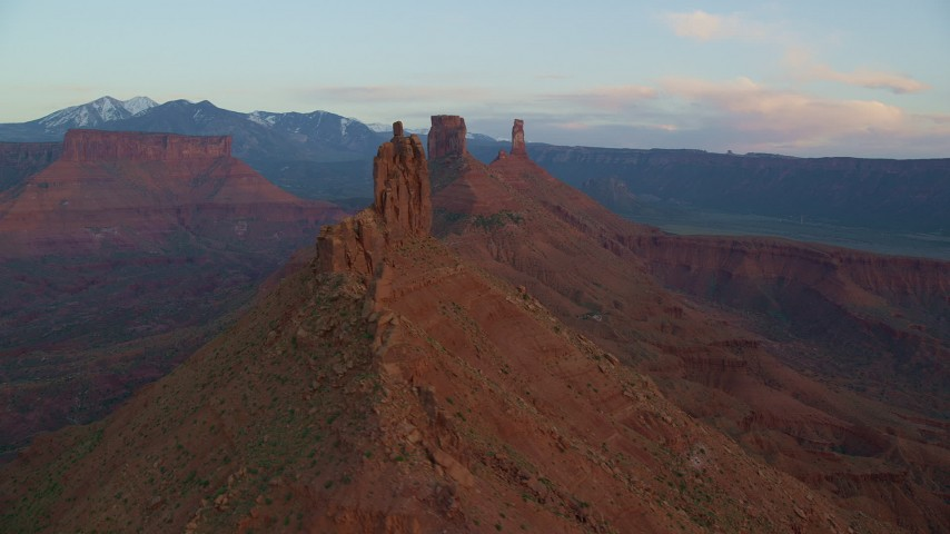 Flying by buttes, Castleton Tower, Moab, Utah, sunset Aerial Stock Footage   AX138_411