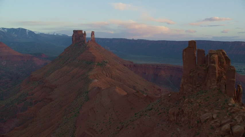 Approaching butte, Castleton Tower, Moab, Utah, sunset Aerial Stock Footage | AX138_412