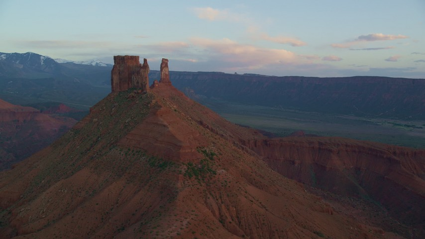 6K stock footage aerial video of approaching a butte and Castleton Tower at sunset, Moab, Utah Aerial Stock Footage | AX138_413