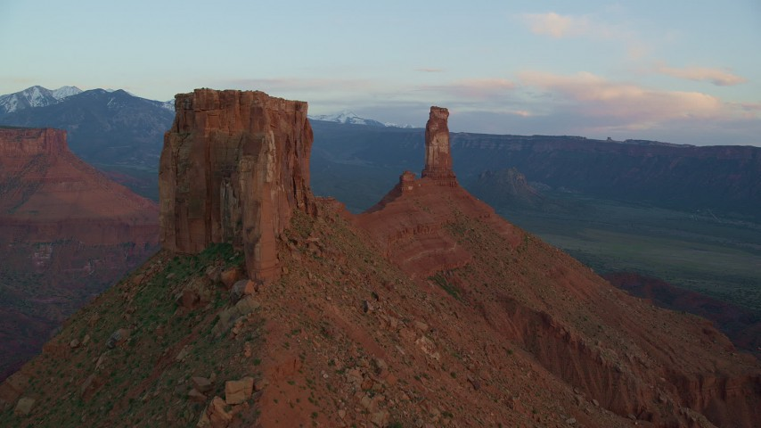 6K stock footage aerial video of flying by a butte, approaching Castleton Tower, Moab, Utah, sunset Aerial Stock Footage | AX138_414