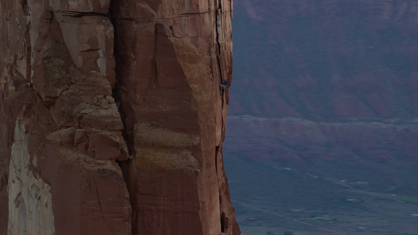 6K stock footage aerial video of a rock climber on Castleton Tower, Moab, Utah, sunset Aerial Stock Footage   AX138_420