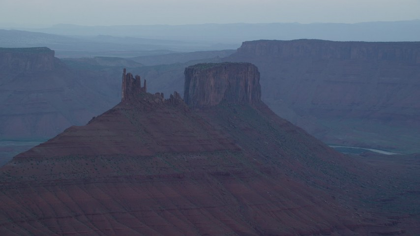 6K stock footage aerial video of a view of two desert buttes in Moab, Utah, sunset Aerial Stock Footage | AX138_425