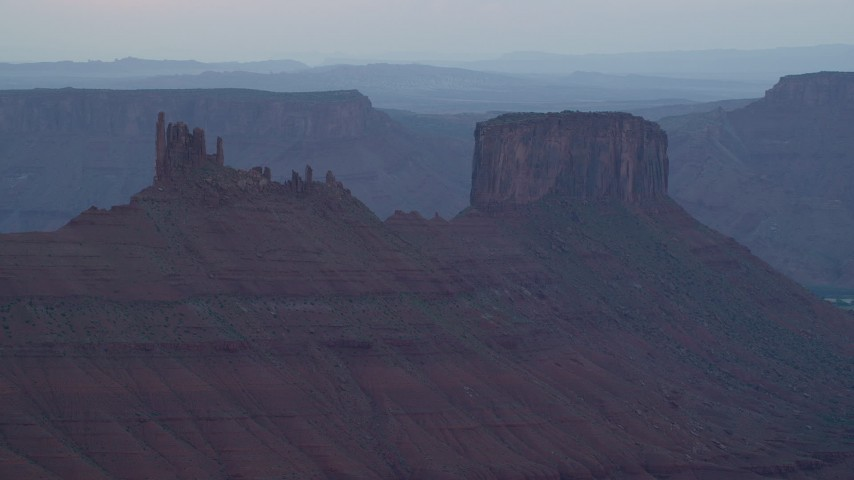 6K stock footage aerial video of passing by two desert buttes, Moab, Utah, sunset Aerial Stock Footage | AX138_426