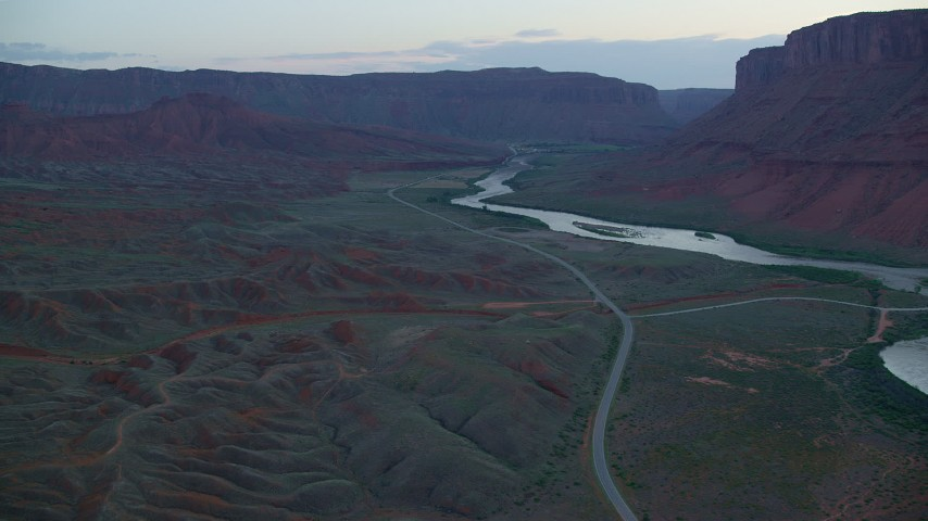 6K stock footage aerial video of flying over State Route 128, approaching the Colorado River, Moab, Utah, twilight Aerial Stock Footage | AX138_456