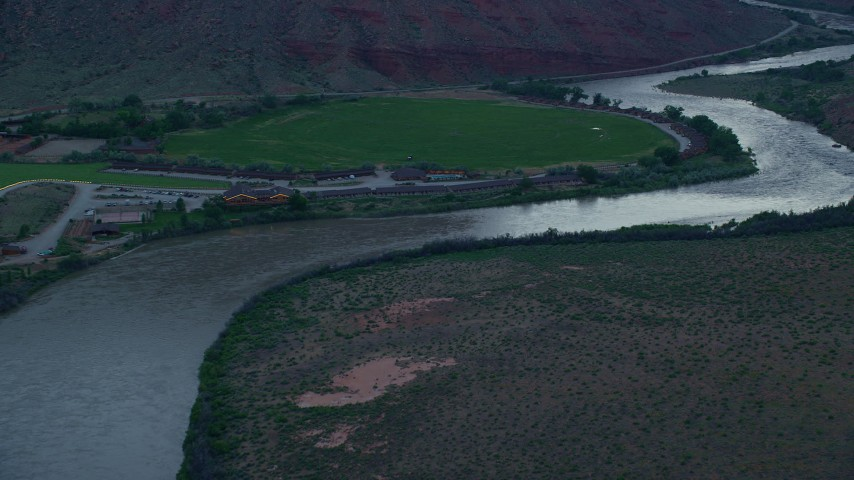 Approaching Red Cliffs Lodge, Colorado River, Moab, Utah, twilight Aerial Stock Footage | AX138_460