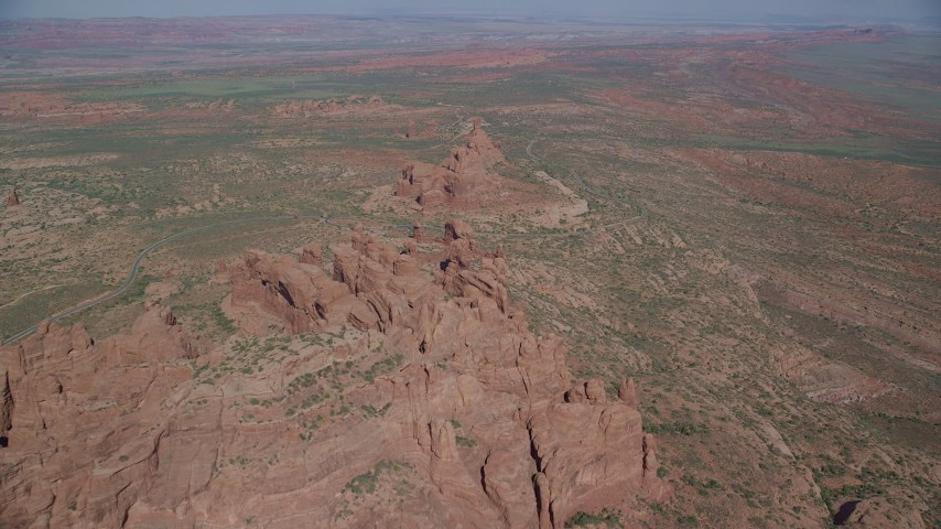 6K stock footage aerial video of flying over rock formations and desert valley, Arches National Park, Utah Aerial Stock Footage | AX139_001