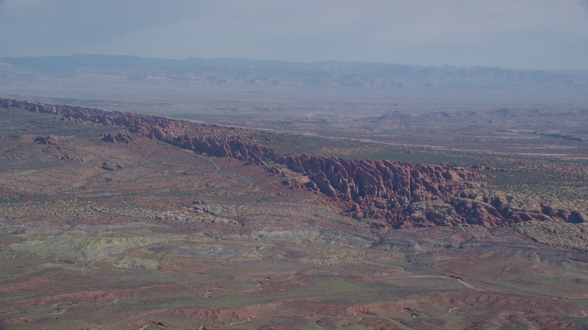 6K stock footage aerial video of flying by Devil's Garden in Arches National Park, Utah Aerial Stock Footage | AX139_003