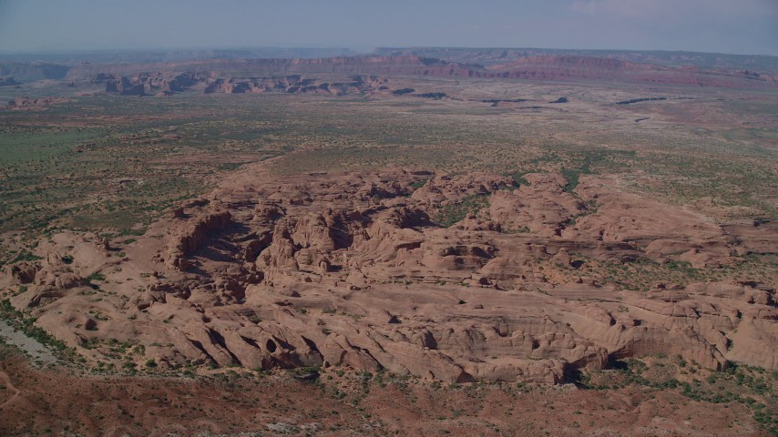 6K stock footage aerial video of passing desert rock formations, Arches National Park, Utah Aerial Stock Footage   AX139_007