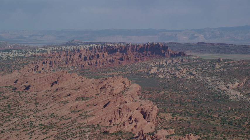 Flying by Devil's Garden, Arches National Park, Utah  Aerial Stock Footage | AX139_011