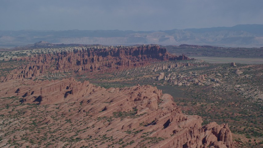 6K stock footage aerial video of passing by rock formations at Devil's Garden, Arches National Park, Utah Aerial Stock Footage | AX139_012