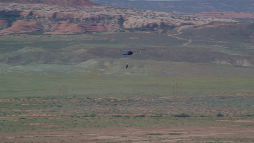 6K stock footage aerial video of a skydiver landing in Canyonlands Field, Utah Aerial Stock Footage | AX139_017