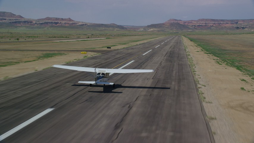 6K stock footage aerial video of tracking Cessna taking off from runway, Canyonlands Field, Utah Aerial Stock Footage | AX139_020