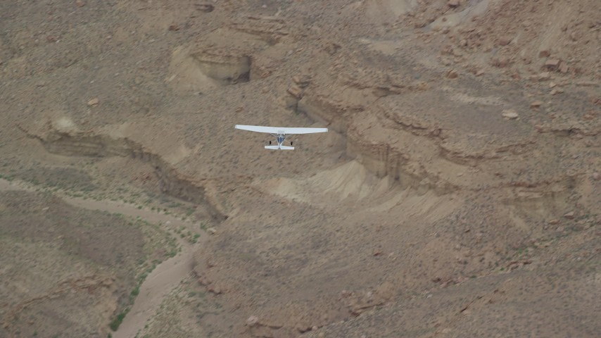 6K stock footage aerial video of tracking a Cessna flying by desert cliffs, Emery County, Utah Aerial Stock Footage | AX139_103