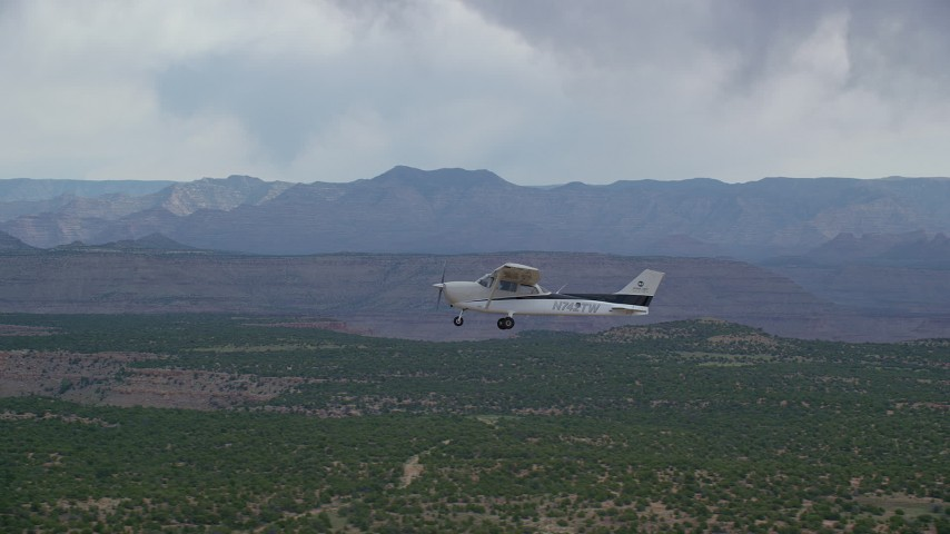 6K stock footage aerial video of tracking Cessna flying by desert mesas, Emery County, Utah Aerial Stock Footage AX139_111 | Axiom Images